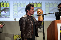 Josh Brolin posing with an Infinity Gauntlet prop while promoting the films at the 2014 San Diego Comic-Con