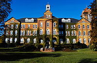 Alumni Hall at Saint Anselm College has served as a backdrop for media reports during the New Hampshire primary.