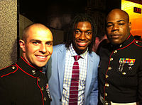 Griffin (center) posing with two marines at the 2012 NFL draft.