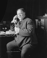 One of a series of candid photographs known as the Evolution of a Smile, taken just after a formal portrait session, as Taft learns by telephone from Roosevelt of his nomination for president.