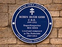 Blue plaque of the Heritage Foundation commemorating Gibb at his home (The Prebendal) in Thame, Oxfordshire