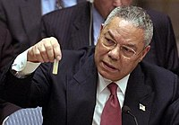 Colin Powell, the US Secretary of State, demonstrates a vial with alleged Iraq chemical weapon probes to the UN Security Council on Iraq war hearings, 5 February 2003