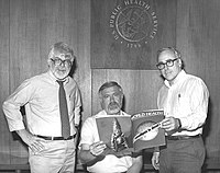 Three former directors of the Global Smallpox Eradication Programme reading the news that smallpox has been globally eradicated in 1980