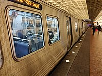 A Blue Line train at Farragut West, an underground station on the Washington Metro