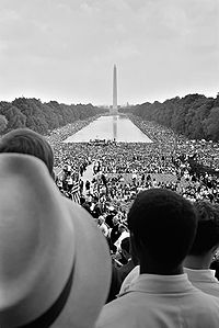 Crowds surrounding the Lincoln Memorial Reflecting Pool during the March on Washington, 1963