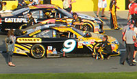 Ambrose's 2011 NASCAR Sprint Cup Series car. In the background is the #31 Caterpillar, Inc. Chevrolet of Jeff Burton.