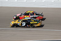 Ambrose (9) battling Jeff Gordon in the 2012 Kobalt Tools 400