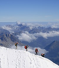 Alpine mountaineers descending from the Aiguille du Midi above Chamonix.