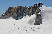Cosmiques Hut near Aiguille du Midi with climbers camping illegally on the glacier below it. July 2010