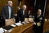 Senators Lieberman and John McCain talk with Navy Adm. Mike Mullen, chairman of the Joint Chiefs of Staff before a Senate Armed Services Committee hearing, 2010