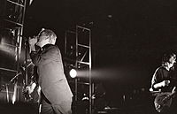 Michael Stipe (left) and Peter Buck (right) on stage in Ghent, Belgium, during R.E.M.'s 1985 tour