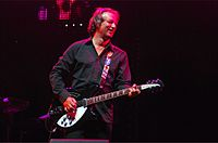 Peter Buck's guitar-playing style has defined R.E.M.'s sound.