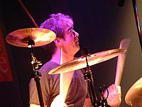 After drummer Bill Berry quit in 1997, R.E.M. continued as a trio.