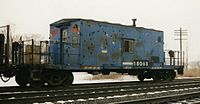 Conrail transfer caboose 18065 brings up the rear of a local freight passing Porter, Indiana, in the early 1990s