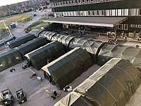 An army-constructed field hospital outside Östra Sjukhuset in Gothenburg on 23 March 2020. The tents contain temporary intensive care units for COVID-19 patients.