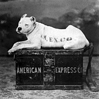 The American Express logo in 1890 depicting a watchdog lying on top of a shipping trunk to symbolize trust and security