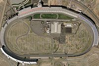 A satellite view of Charlotte Motor Speedway, a typical NASCAR track with a quad-oval configuration. The infield roval also hosts a Cup Series event, with the inaugural event in 2018.