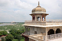 View of Musamman Burj from northwest, with the Yamuna river and the Taj Mahal