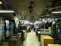 Souq al-Dira', maintaining its traditional role as a tailoring centre