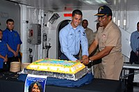 A U.S. Navy vice admiral and an intelligence specialist celebrating Hispanic American Heritage Month in San Diego