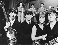 McCartney, Harrison, Swedish pop singer Lill-Babs and Lennon on the set of the Swedish television show Drop-In, 30 October 1963