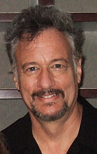 John de Lancie plays the role of the mysterious but powerful alien known as Q. Like many actors in the series, he also worked on some of the video games of the period.
