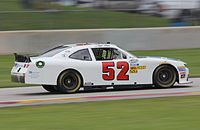 Gase racing the No. 52 Means Racing car at Road America in 2014