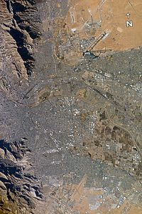 El Paso (top) and Ciudad Juárez (bottom) seen from earth orbit; the Rio Grande is the thin line separating the two cities through the middle of the photograph. El Paso and Juarez make up the third largest U.S. international metroplex after Detroit–Windsor and San Diego-Tijuana.