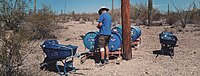 A volunteer from the Humane Border group is refilling water stations located on the desert of the U.S.-Mexico border.