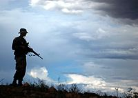 A U.S. Army National Guard member working with the U.S. Border Patrol in support of Operation Jump Start, Arizona, July 2006.