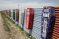 Memorial coffins on the US-Mexico barrier for those killed crossing the border fence in Tijuana, México.