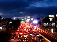 Thousands of cars sit from fifteen minutes to two hours waiting to cross the border.