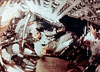 Still from film of the crew taken while they were in orbit around the Moon. Frank Borman is in the center.