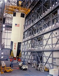 The first stage of AS-503 being erected in the Vehicle Assembly Building (VAB) on February 1, 1968