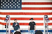 Cerrone (right) on stage with Anthony Pettis for a USO tour