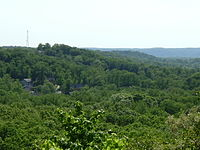 Hilly terrain blankets the southwest part of the city.
