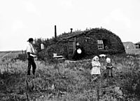 Norwegian settlers in front of their sod house in North Dakota in 1898