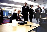 President George W. Bush is briefed on the attacks in Sarasota, Florida.