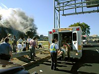 EMS workers rescue and evacuate an injured victim of the Pentagon attack.