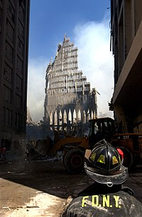 A fireman looks up at the remains of the South Tower.