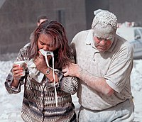 Two survivors are covered in dust after the collapse of the towers.