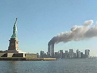 The Statue of Liberty with the towers burning in the background