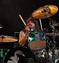 Dave Grohl, shown here drumming with Josh Homme side project Them Crooked Vultures has recorded and toured with Queens of the Stone Age