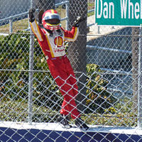 Castroneves climbing the fence to celebrate his win in the 2012 Honda Grand Prix of St. Petersburg
