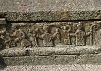 A bishop with other officials on an 11th-century grave in Sweden.