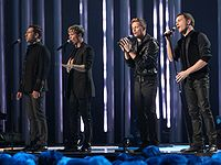 """Irish boy band Westlife achieved the first number one on the UK Singles Downloads Chart with """"Flying Without Wings"""" in September 2004."""