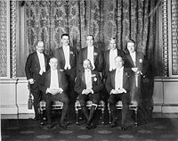 1926 Imperial Conference: George V and the prime ministers of the Empire. Clockwise from centre front: George V, Baldwin (United Kingdom), Monroe (Newfoundland), Coates (New Zealand), Bruce (Australia), Hertzog (South Africa), Cosgrave (Irish Free State), King (Canada).
