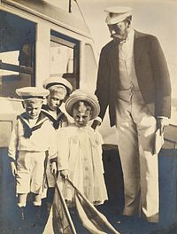 George with his children, Edward, Albert, and Mary, photographed by Alexandra in 1899