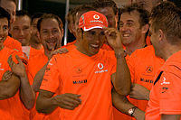 Hamilton and his team celebrate his maiden Formula One World Championship title in 2008.