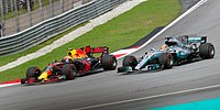 Max Verstappen overtaking Hamilton for the lead in Malaysia.
